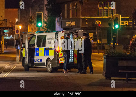 Salisbury Wiltshire, England, 16th September 2018  A man is loaded into a police van after being arrested for being drunk and disorderly at the police barrier for suspected novichok incident in Prezzos Salisbury.  He had repeated sworn at police, used abusive language and attempted to cross the cordon   Credit Estelle Bowden/Alamy news Credit: Starsphinx/Alamy Live News - Stock Image