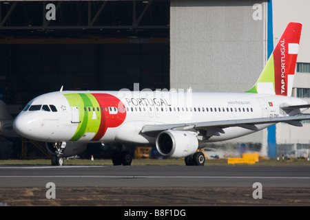 TAP Portugal Airbus A320 taxiing for departure at London Heathrow Airport, United Kingdom - Stock Image