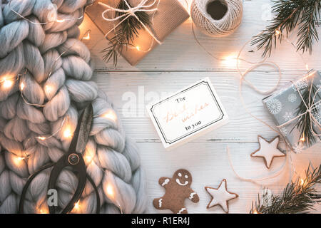 Christmas letter,fruits,gift boxes and warm sweater - Stock Image
