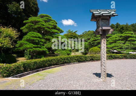 Lantern in the garden of complex Ise Jingu, Japan - Stock Image