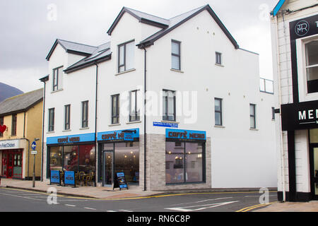 14 December 2018 A typical Caffe Nero Coffee shop front in Newcastle County Down Northern Ireland. Although in mid winter there are on street coffe ta - Stock Image