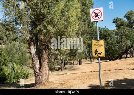 Signs advising owners to keep their dog on a lead and to clean up their excrement, Tamworth Australia. - Stock Image