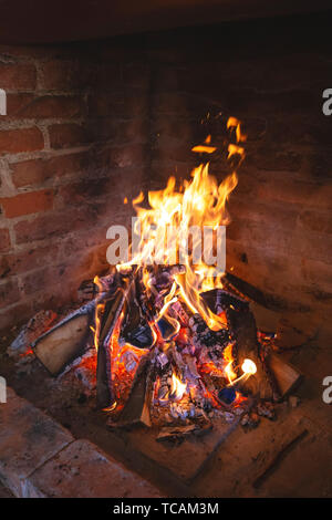 Fireplace fire for preparing traditional croatian dish peka, vertical view - Stock Image