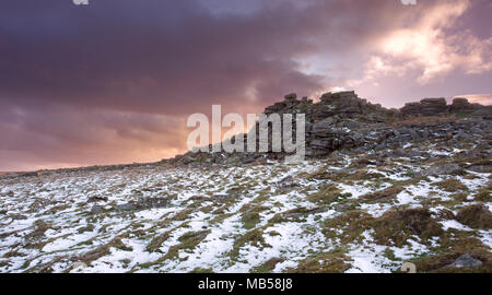 Light dusting of snow on West mill tor Dartmoor National Park Devon Uk - Stock Image