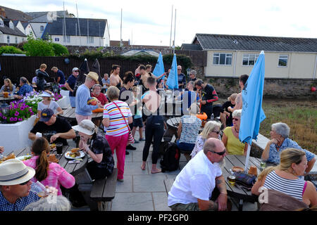 Topsham, Devon, UK. People enjoying a meal prior to the Topsham swim race, August 2018 - Stock Image