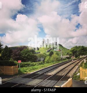 A view of Corfe Castle from the Corfe Castle railway station. Purbeck, Dorset. - Stock Image