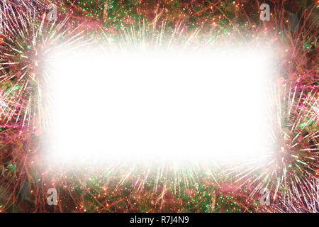 Colorful fireworks with white rectangle copy space in the middle - Stock Image