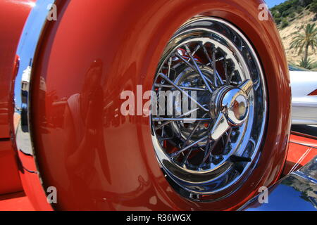 Close up shot of a spare tire on a red retro car - Stock Image