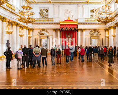 19 September 2018: St Petersburg, Russia - Visitors in St George's Hall, or the Great Throne Room, in the Winter Palace, part of the Hermitage Museum. - Stock Image