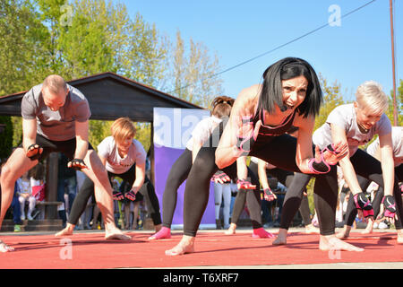 Nis, Serbia - April 20, 2019 Piloxing sport training group of people on sunny spring day outdoor with teacher - Stock Image