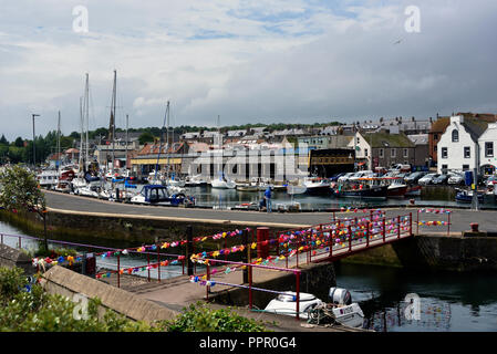Decorated bridge for the Herring Queen Festival. The Harbour. Eyemouth, Scottish Borders, Berwickshire, Scotland, United Kingdom, Europe. - Stock Image