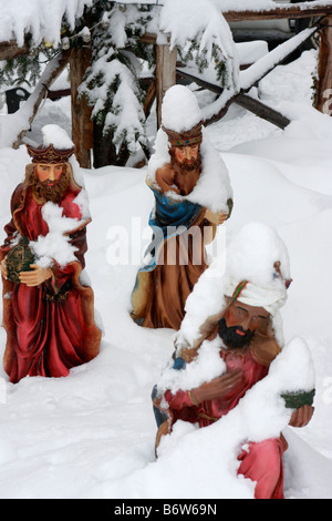 Three wise Men bearing gifts ,set in real snow ,part of the outdoor nativity scene in Montemonaco,Le Marche,Italy - Stock Image
