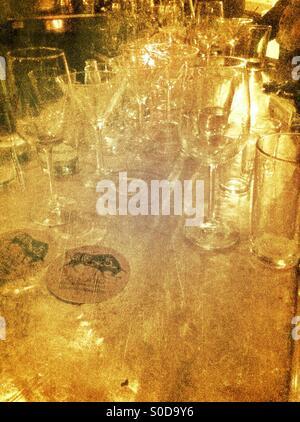 Glasses at bar - Stock Image