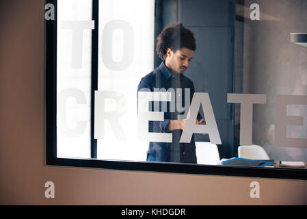 Young man using smart phone - Stock Image