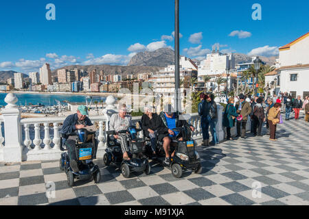 Group of elderly people on mobility scooters in Benidorm, Spain - Stock Image