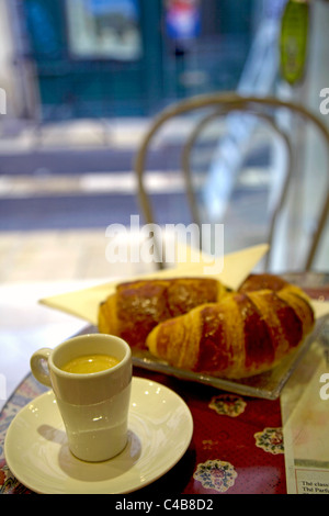 Arles; Bouches du Rhone, France; Coffee and Croissant in one of the cafes in the historical city - Stock Image