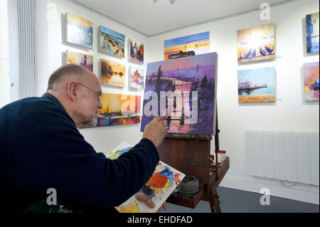 Picture by Roger Bamber : 21 February 2015 : Brighton Artist Colin Ruffell works on an Acrylograph of a Painting - Stock Image