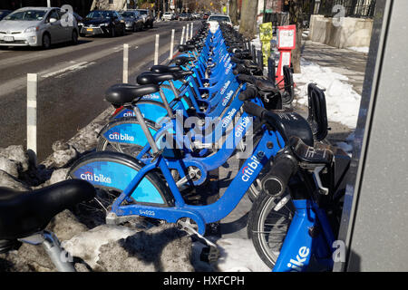 Citi bank bikes docked in New York City. Citi bike is a bike sharing system available throughout the five boroughs. - Stock Image