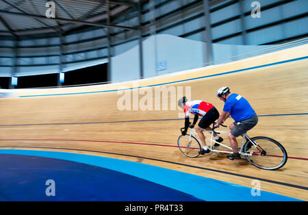 Derby, UK. 28th September, 2018. Blind author Simon Mahoney riding pillion on a tandem bicycle in the Derby Arena Velodrome for Blind Veterans UK Friday 28th September 2018 Credit: Doug Blane/Alamy Live News - Stock Image