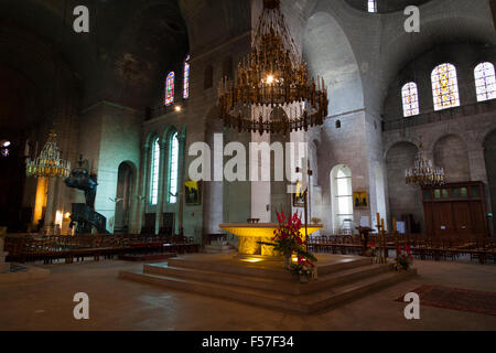 altar with candelabra Inside the cathedral of Saint Front in Perigueux France - Stock Image
