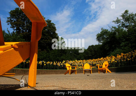 NEW YORK, NY - JULY 10: Yellow pinwheels placed in Prospect Park's Rose Garden as part of the Park's 150th anniversary, Brooklyn on JULY 11th, 2017 in - Stock Image