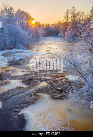 Sunrise in cold winter river landscape - Stock Image