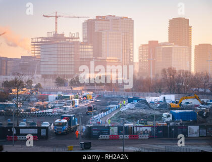 Frosty, foggy morning over the Sweetwater & East Wick development site in the Olympic Park, East London,  International Quarter in the background. - Stock Image