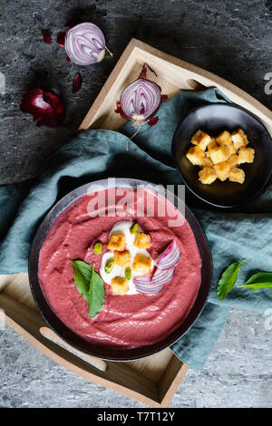 Delicious creamy beetroot soup with sour cream and crispy baked tofu - Stock Image