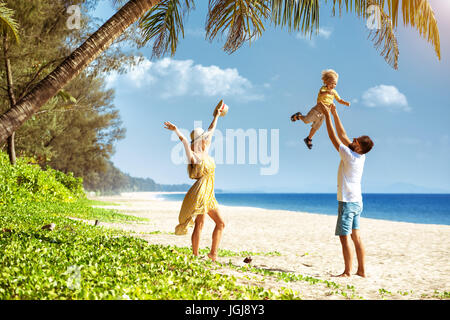 Happy family tropical beach having fun - Stock Image