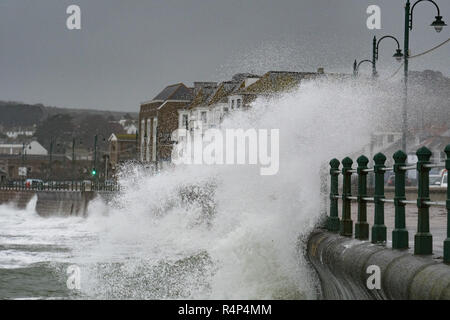 Penzance, Cornwall, UK. 28th November 2018. UK Weather. For a second day Penzance seafront is being hit by strong winds and big waves brought on by Storm Diana.  It was still mild though, at 14.5 degrees C at 7 am. Credit: Simon Maycock/Alamy Live News - Stock Image