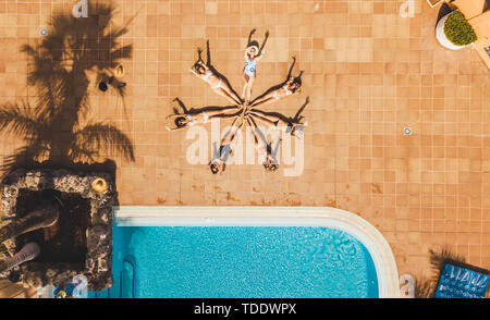 Vertical top view of group of women young friends compose a star together with their bodies - concept of summer people vacation lifestyle and friendsh - Stock Image