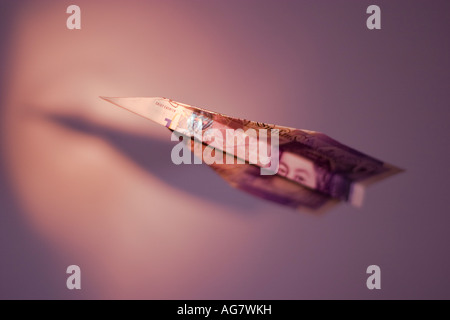Airplane made from British Pound note - Stock Image
