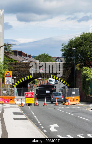 Low railway overbridge on Weston Street, Bolton, fully closed to road traffic for repair work lasting several weeks in the summer of 2017. - Stock Image