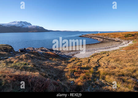 West coast landscape of pebble beach leading to Rhue Lighthouse looking across loch broom to Beinn Ghobhlach, Scottish Highlands, Scotland, UK, Europe - Stock Image