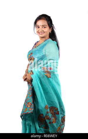 A beautiful Indian woman in a traditional saree, on a white studio background. - Stock Image