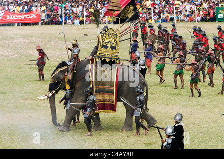 Thailand, Surin, Surin.  Ancient war re-enactment in Srinarong Stadium during the Elephant Roundup festival. - Stock Image