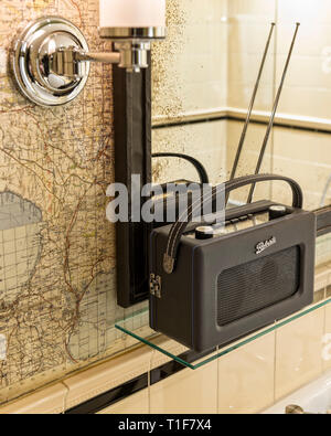 'Radio by map tilework in bathroom of The Zetter Townhouse in London, England' - Stock Image