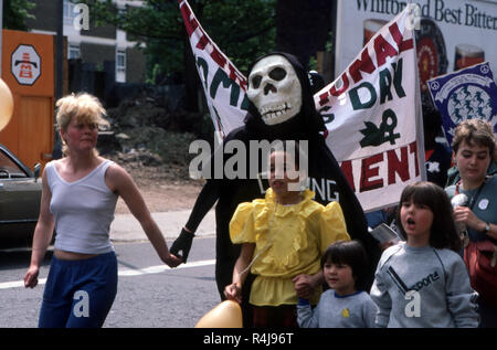 Anti-nuclear Demonstration in London in the 1980's with protester wearing a skull mask and clock that reads Cruising to Death - Stock Image