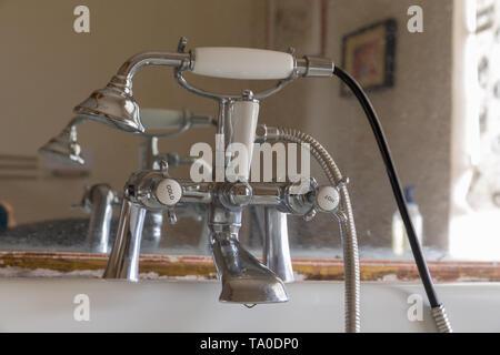 Retro antique bathroom closeup of the taps and shower - Stock Image