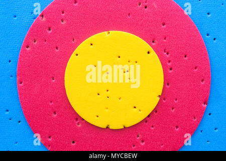 Close-up of a relatively new archery target - with gold, red and blue scoring rings. - Stock Image