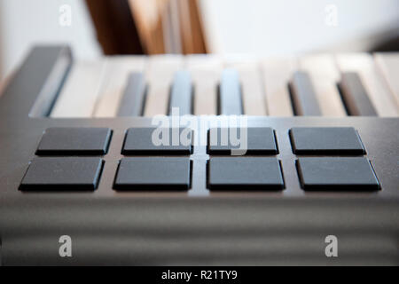 A digital piano keyboard with midi pads for creating sounds - Stock Image