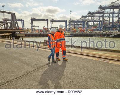 Dock workers walking at Port of Felixstowe, England - Stock Image