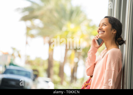 Young woman on her mobile phone. - Stock Image