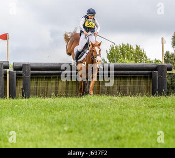 Rockingham Castle grounds, Corby, England. Saturday 20th May 2017. Boo Guest and her horse Nanteglwys Brynmor leap - Stock Image