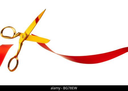 Gold Scissors Cutting RedTape Symbolising Brexit - Stock Image