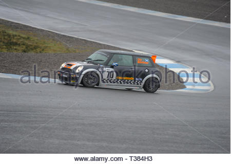 Dunfermline, Scotland, UK. 7th April, 2019.   70 Oliver Mortimer at the Hairpin during a Scottish Fiesta/Mini Cooper S Cup  race at Knockhill Circuit. During a wet and misty opening round of the Scottish Championship Car Racing season organised by the SMRC (Scottish Motor Racing Club) at Knockhill. Credit: Roger Gaisford/Alamy Live News - Stock Image