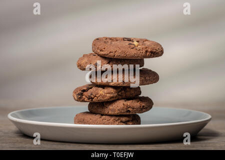 stack of homebaked chocolate chip cookies on a plate - Stock Image