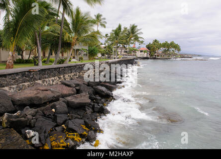 Fortified sea wall beach to prevent erosion by the sea rising sea levels, near Hulihe'e Palace,  Kailua Kona, - Stock Image