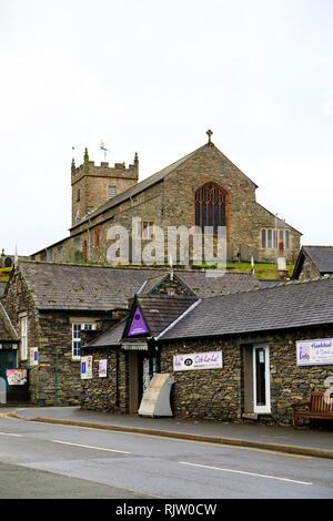 St Michael and All Angels parish church, above the Ooh-La-La newsagents, Hawkshead, Lake District, Cumbria, England - Stock Image