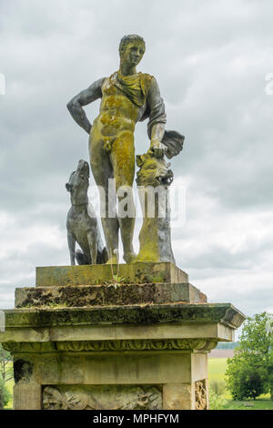 A statue of Meleaguer the famous hunter with his hound and a newly slain boar at Castle Howard Yorkshire UK - Stock Image